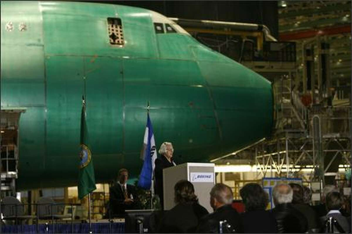 Millie Hughes, who has worked for Boeing for 55 years, speaks to several hundred Boeing employees gathered Tuesday morning to celebrate Boeing's 40th anniversary at the Everett Plant.