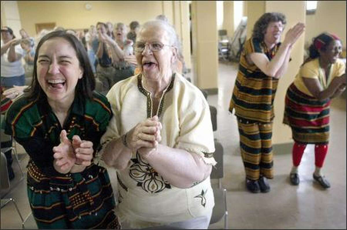 Goofy dances, stuck-out tongues -- hey, this is just the warm-up for World Laughter Day at Phinney Neighborhood Center. Judy Cashman, left, and Elva Dodd join in.
