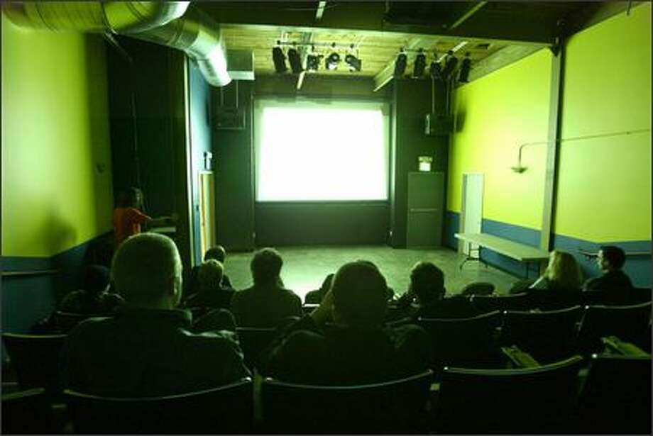 Novice and professional filmmakers show their creations to an audience for feedback once a month at 911 Media Arts Center's Open Screening night. Photo: Mike Urban, Seattle Post-Intelligencer / Seattle Post-Intelligencer