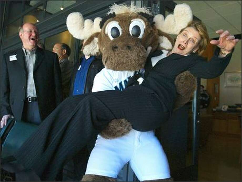 When the Mariner Moose asked Gov. Christine Gregoire on Opening Day to put down her coffee, she had no idea he was planning to pick her up. The surprised governor was a good sport about it. Photo: Meryl Schenker, Seattle Post-Intelligencer / Seattle Post-Intelligencer