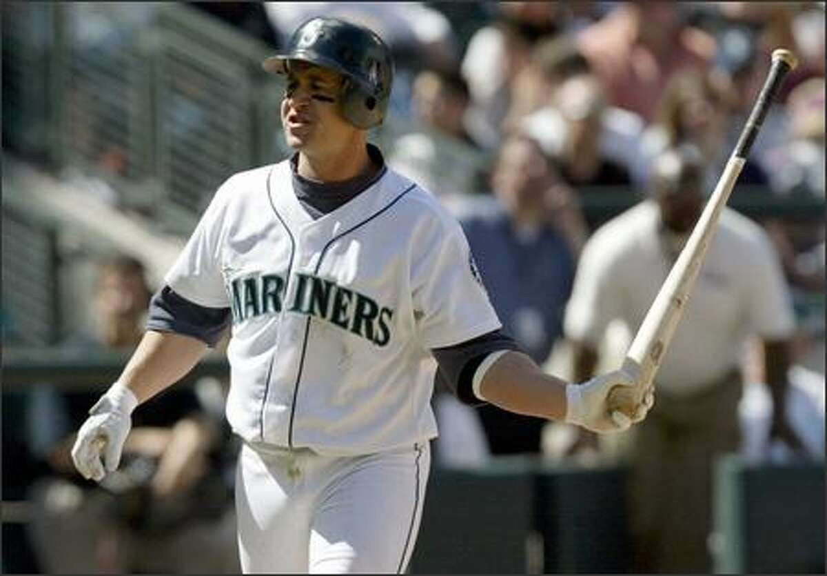 Bret Boone throws his bat after striking out during the seventh inning. Boone went 0-for-4 to finish the homestand 3-for-22. His average dropped to .244.