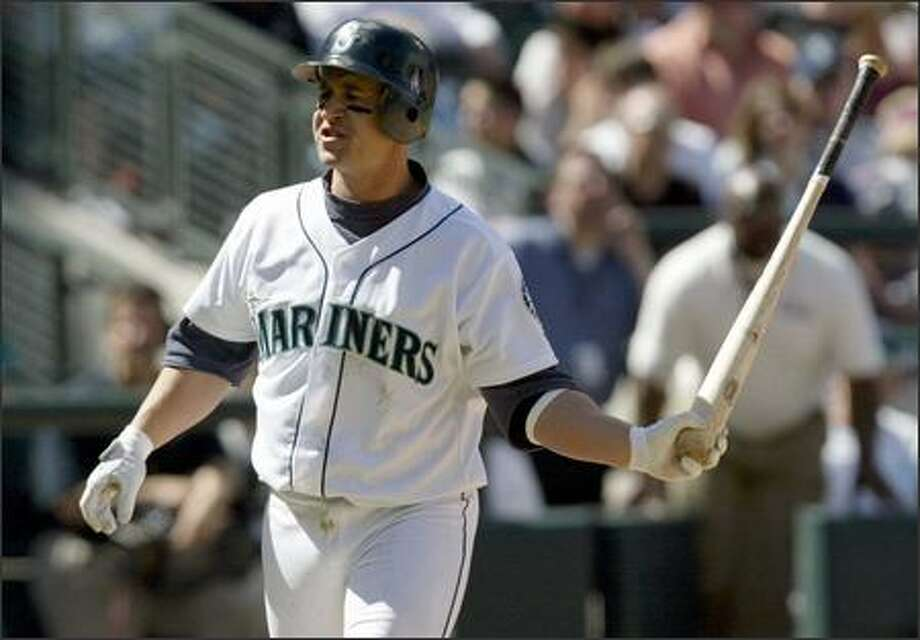 Bret Boone throws his bat after striking out during the seventh inning. Boone went 0-for-4 to finish the homestand 3-for-22. His average dropped to .244. Photo: Joshua Trujillo, Seattlepi.com / seattlepi.com