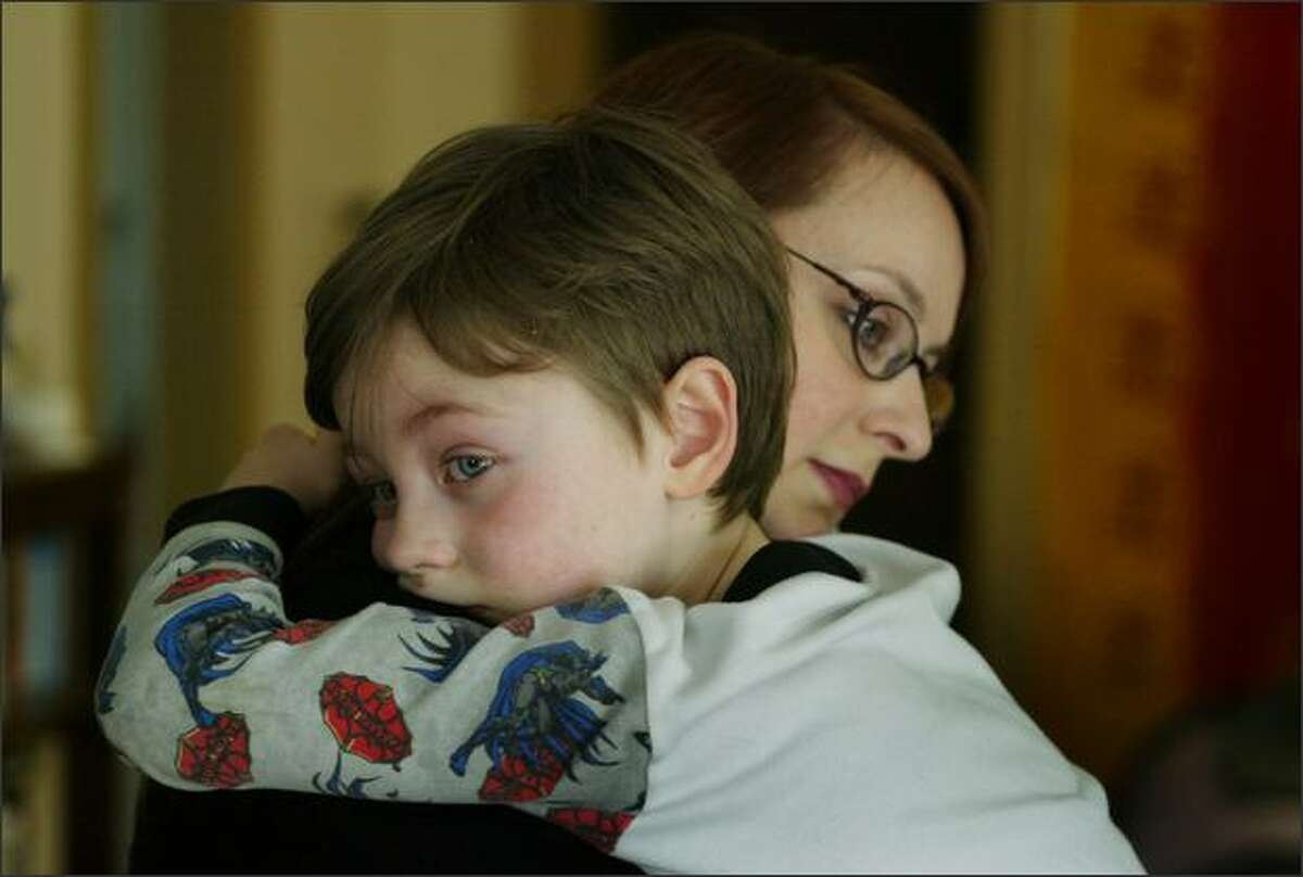 Sharky McGarry, who has autism, is comforted by his mother Lillie McGarry after he became upset.