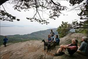 Hikers take in the views from the top of Oyster Dome on Blanchard Mountain.