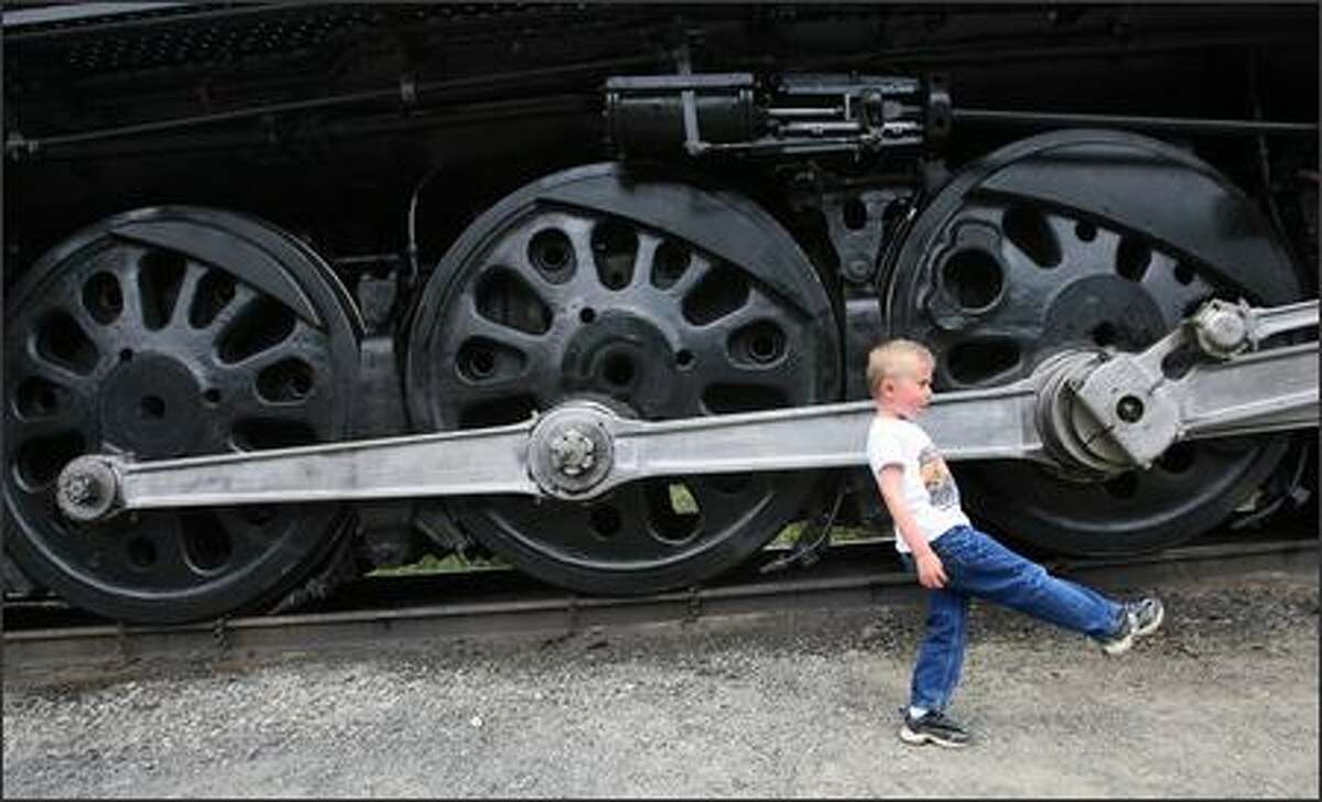 Five-year-old Stephen Breckenridge of Mount Vernon marches along as he gets a close-up look at Steam Locomotive No. 844, the last steam engine built for Union Pacific Railroad. It was delivered in 1944. A high-speed passenger engine, it pulled such widely known trains as the Overland Limited, Los Angeles Limited, Portland Rose and Challenger. It is currently on display at the rail yard in Fife.