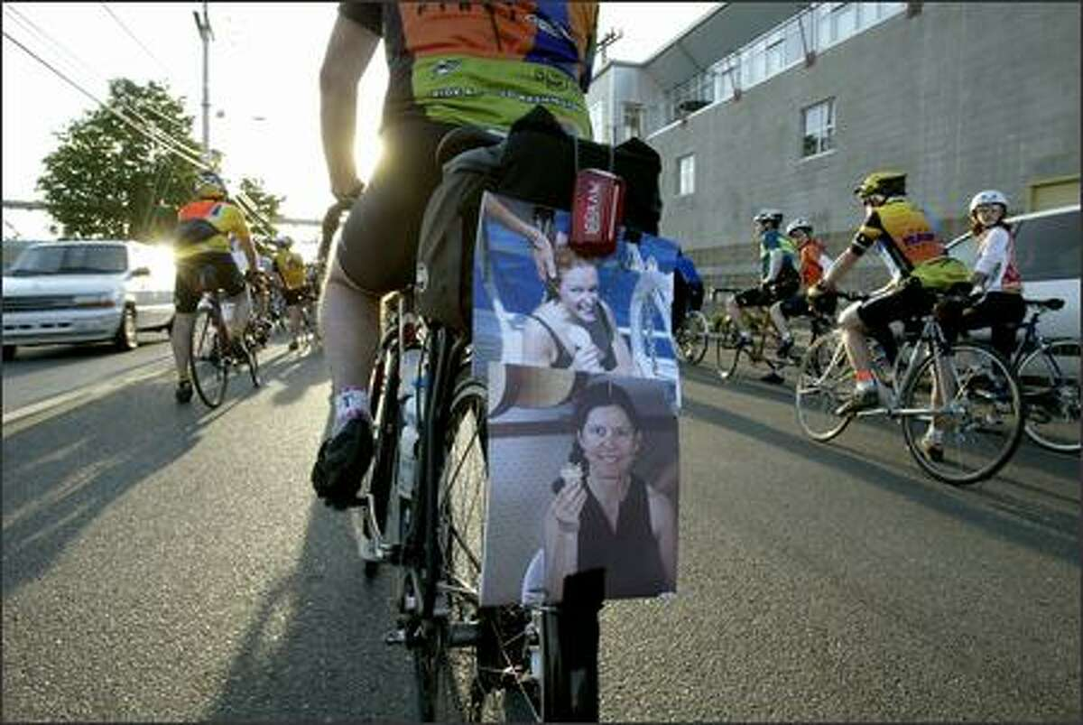 Photos of Gail Alef of Kirkland and Cecy Krone of Santa Rosa, Calif., who were killed in traffic accidents while cycling, are pinned to the saddlebags on Mike Anderson's bicycle as he takes part Wednesday in the Ride of Silence through Seattle. The 20-mile ride, part of a nationwide event, was held in memory of cyclists who have died in traffic accidents. The state Transportation Department's most recent statistics show that seven cyclists were killed in this state in 2004.