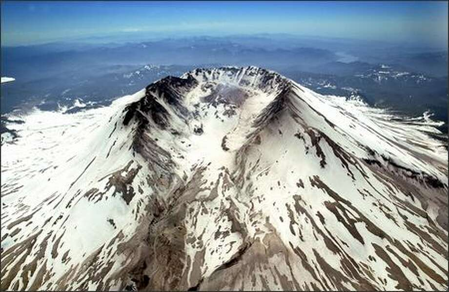 "This aerial view of the crater of Mount St. Helens gives no insight into the question that's ""driving everyone nuts"" in the volcano-watching research community: Why the volcano has been so active of late. Photo: Scott Eklund, Seattle Post-Intelligencer / Seattle Post-Intelligencer"