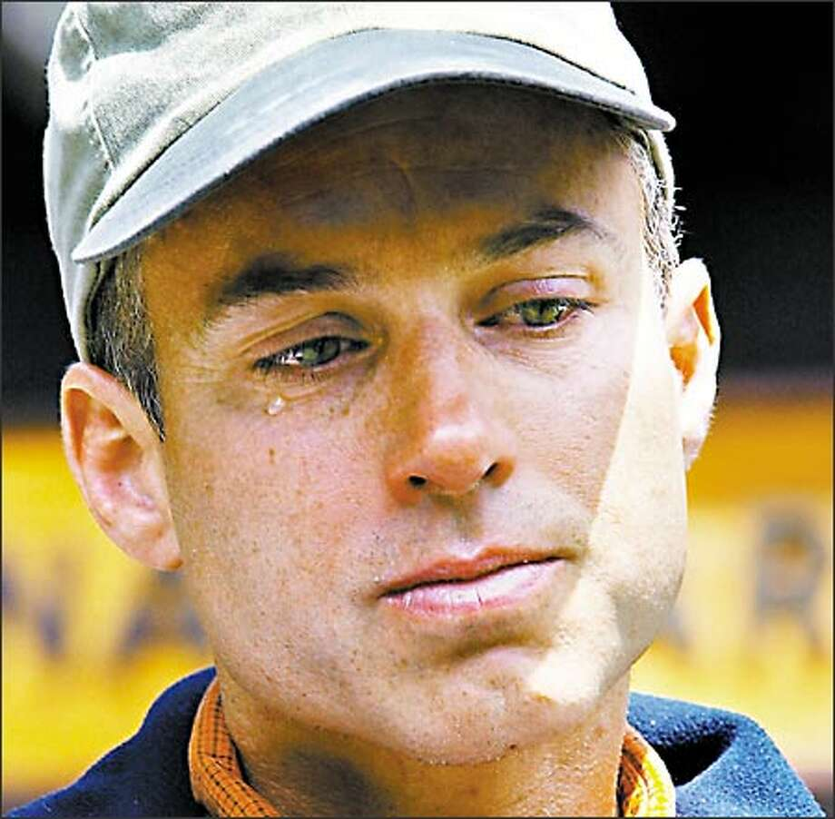 Climber Scott Richards cries during a news conference at Longmire Ranger Station. Richards, whose climbing partner Peter Cooley died Monday, was too exhausted to speak to the media after a rescue helicopter airlifted him off Mount Rainier Tuesday. Photo: Meryl Schenker, Seattle Post-Intelligencer / Seattle Post-Intelligencer