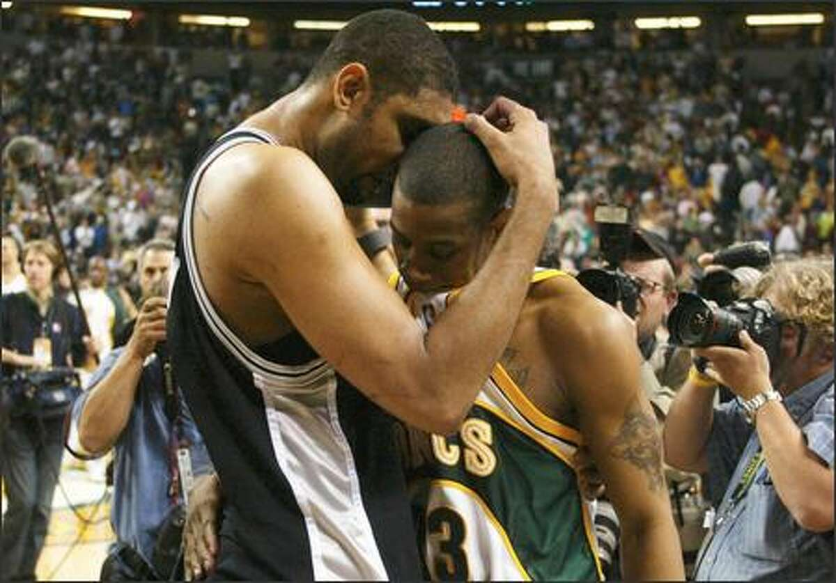 San Antonio's Tim Duncan, left, consoles Seattle SuperSonics guard Antonio Daniels after the Spurs prevailed in Game 6 of the Western Conference Semifinals, eliminating Seattle from postseason contention. The two were teammates in San Antonio. Duncan overcame a terrible shooting night to score 26 points.
