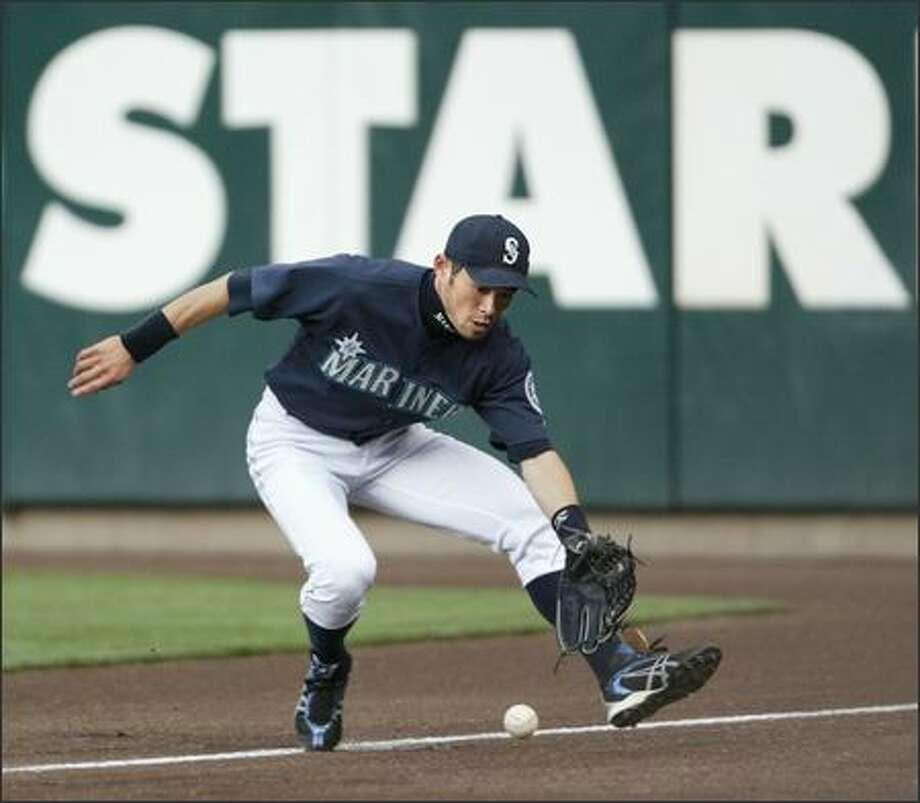 Ichiro Suzuki fields a ball hit down the right-field line for a double by Baltimore's Luis Matos in the fourth inning. Photo: Scott Eklund, Seattle Post-Intelligencer / Seattle Post-Intelligencer