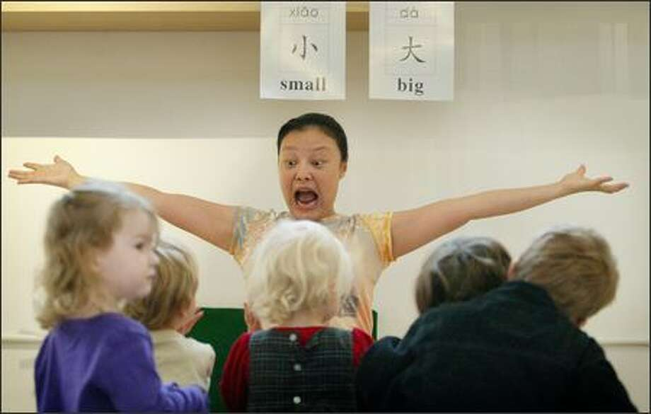 Wenxin Huang-Gillis teaches Mandarin to young children at Sponge, a language school in Seattle for kids up to 5 years of age. Toddlers are believed to pick up foreign languages more easily at that age. The school also offers instruction in Spanish, French and Japanese. An 18-week program of classes once a week costs $475. Photo: Paul Joseph Brown, Seattle Post-Intelligencer / Seattle Post-Intelligencer