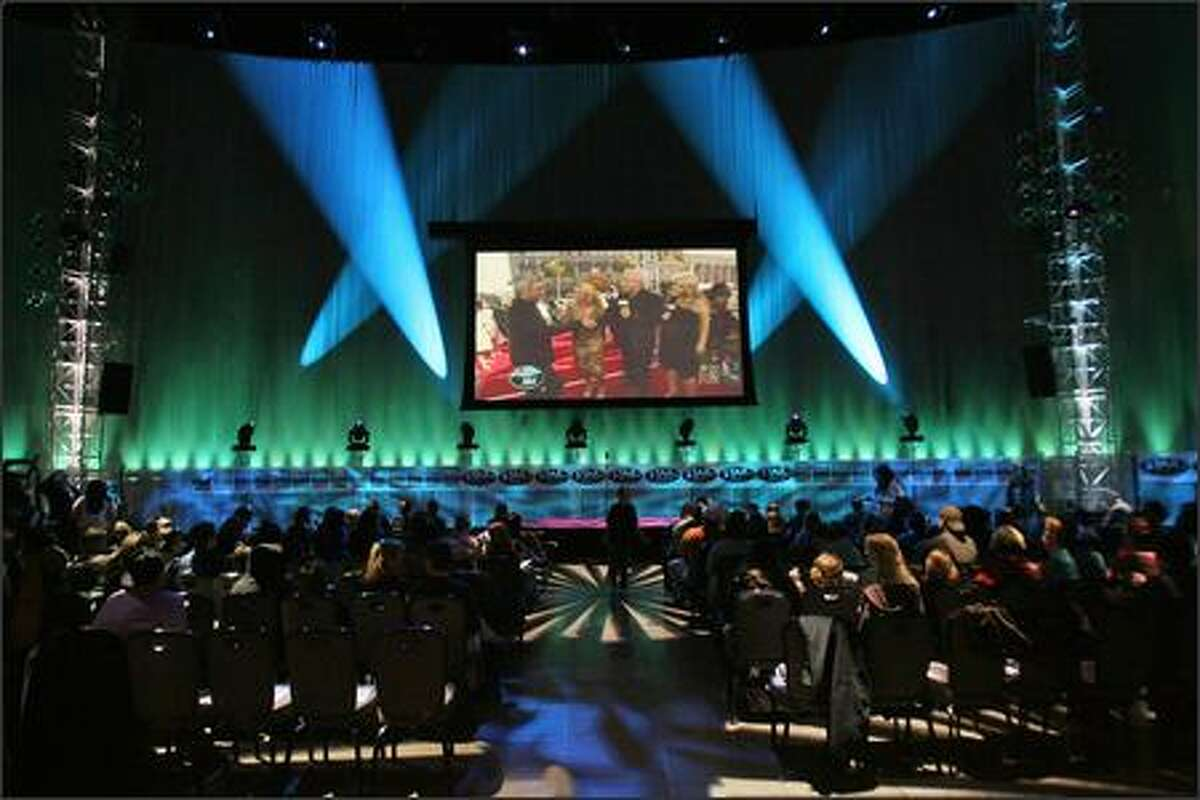 """Supporters of """"American Idol"""" finalist Blake Lewis gathered at the Experience Music Project Sky Church to watch the season's final episode. The Bothell native lost to Jordin Sparks."""