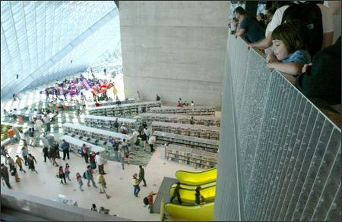 Julia Robaidek, 6, of Seattle has a bird's-eye view of patrons exploring the new Seattle Public Library during the building's opening yesterday.