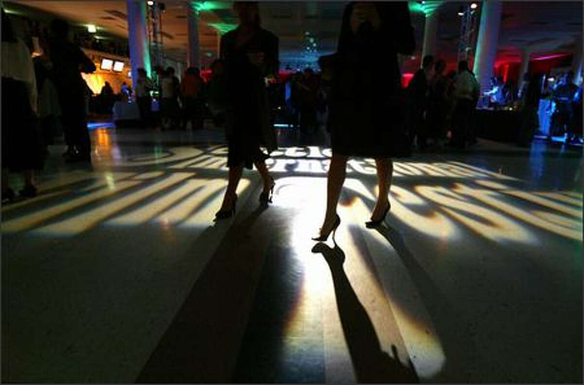 Fans attending SIFF's opening-night gala walk across the festival logo projected on the floor at McCaw Hall.