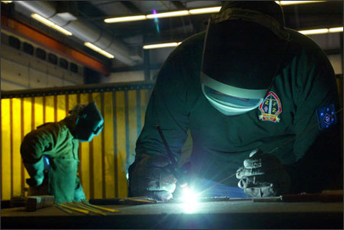 Byron Anderson, 22, a former Marine who suffers from PTSD, practices his welding at Skagit Valley College in hopes of improving his job skills.