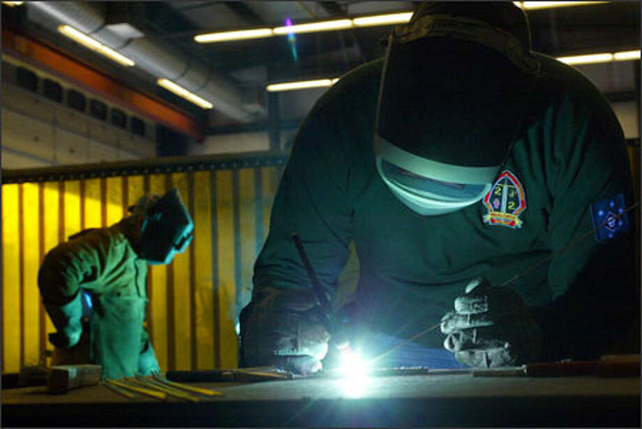 Byron Anderson, 22, a former Marine who suffers from PTSD, practices his welding at Skagit Valley College in hopes of improving his job skills. Photo: Karen Ducey, Seattle Post-Intelligencer / Seattle Post-Intelligencer