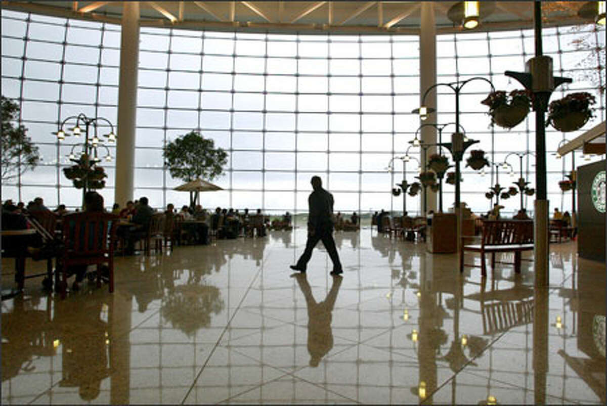 The centerpiece of Sea-Tac International Airport's new Central Terminal is a 60-by-350-foot glass wall that offers a spectacular overview of activity on the runway.