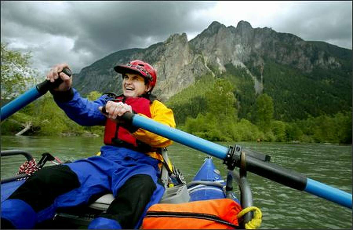 Steve Reutebuch oars his cataraft along the Snoqualmie River during an outing with the Paddle Trails Canoe Club.