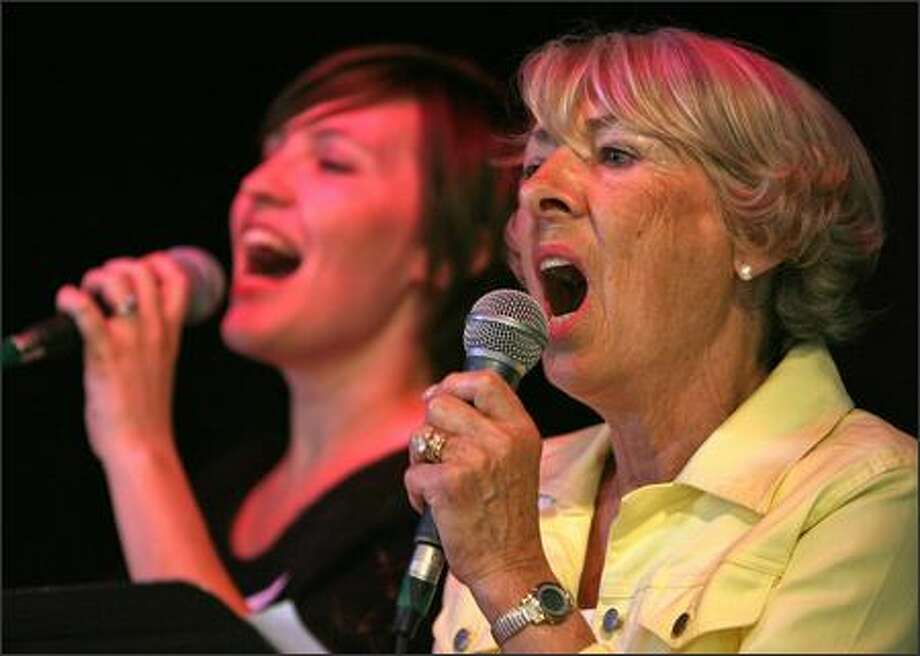 Quest Church member Katey Hage and Interbay Church member Jeanne Denman sing backup vocals for the Quest church band during services Sunday. Photo: Mike Urban, Seattle Post-Intelligencer / Seattle Post-Intelligencer