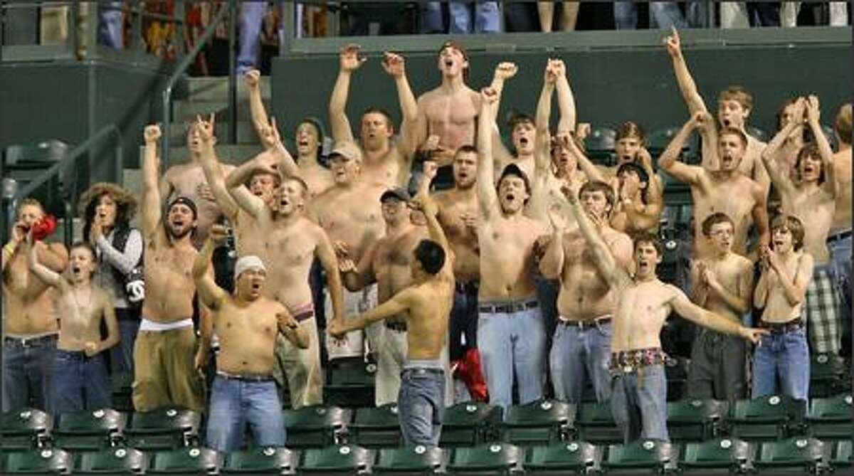 Half-naked Mariners fans cheer the final out in the home team's 5-4 win over the Baltimore Orioles.
