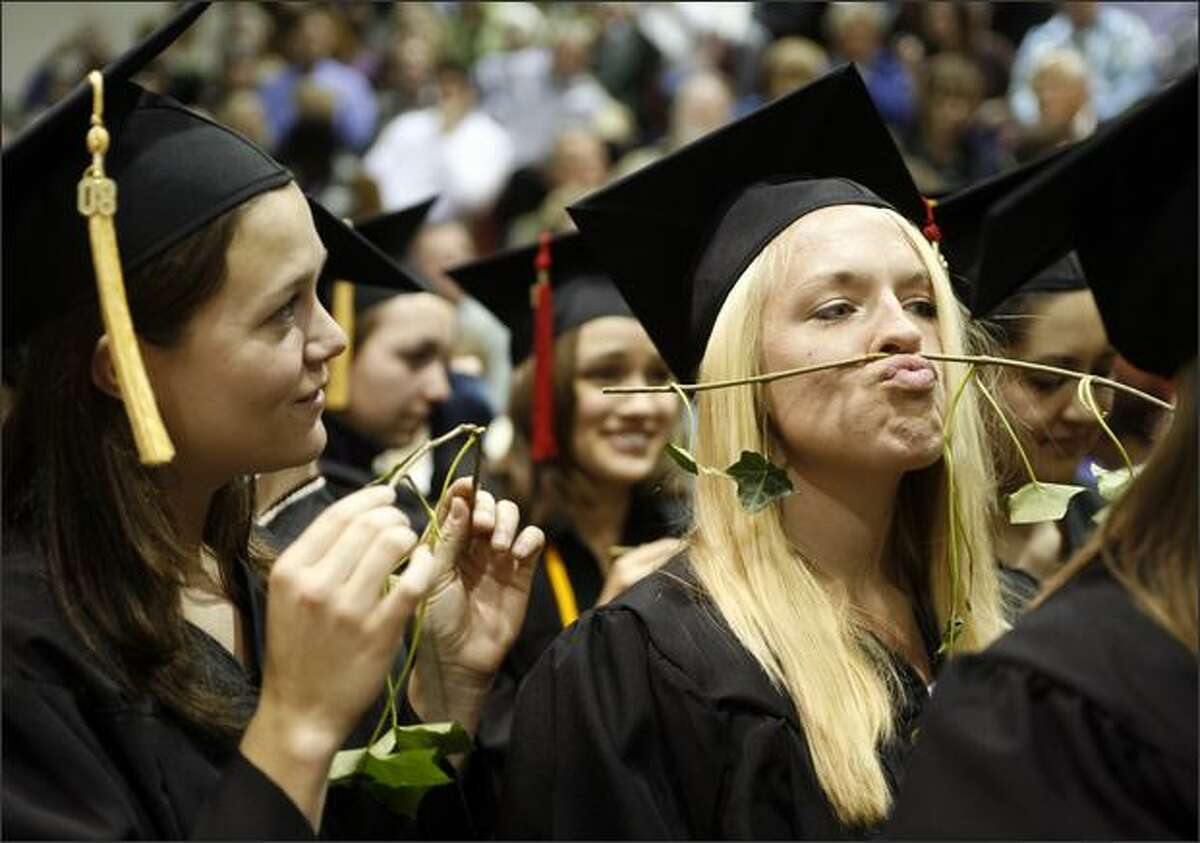 Sarah Reed makes a mustache with her piece of ivy during Seattle Pacific University's annual ivy cutting ceremony.
