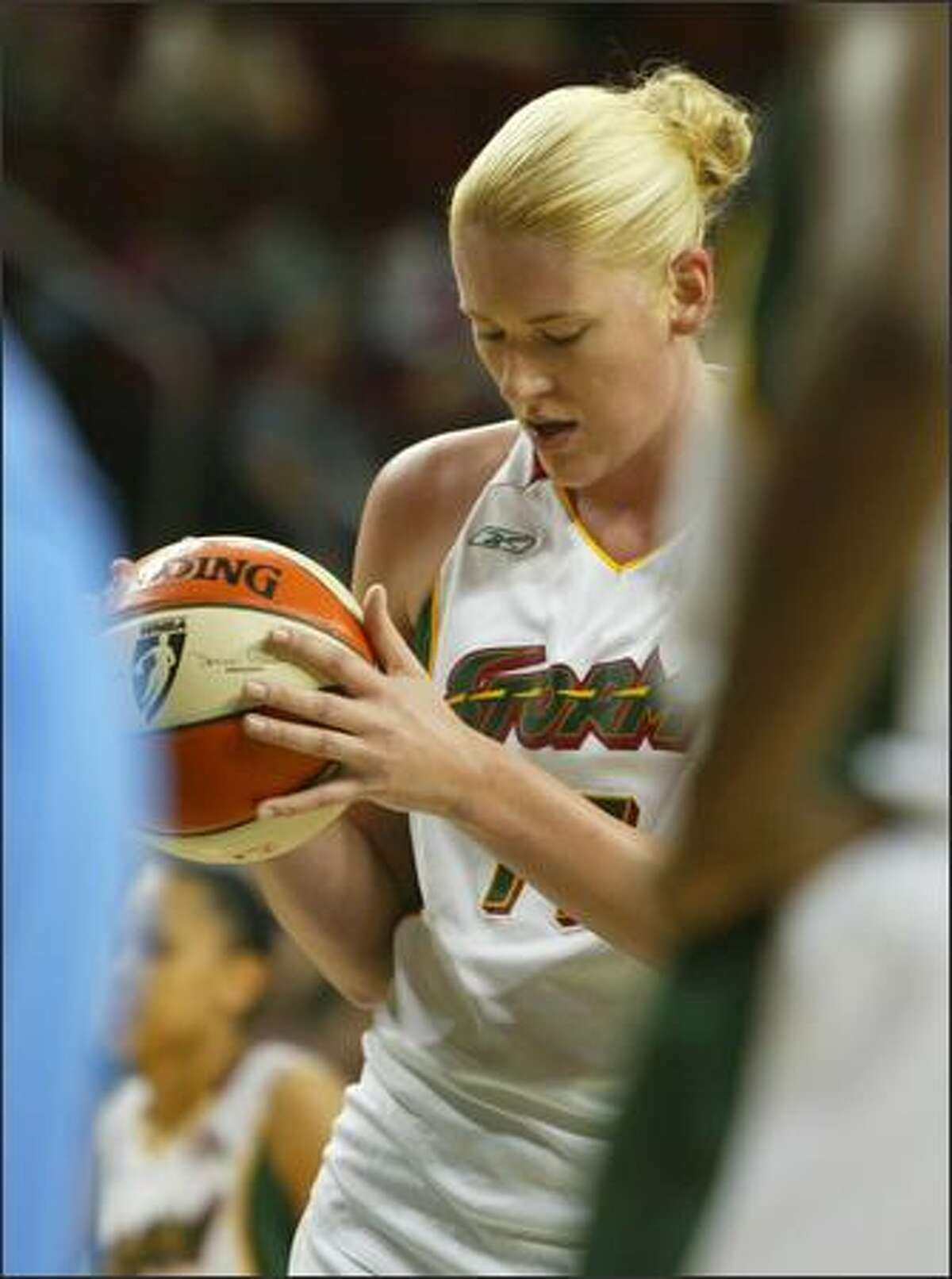 Lauren Jackson looks for the foul line as she prepares to shoot her 3,000th point in the WNBA during a game against the Chicago Sky in Seattle. She made it, became the youngest of 11 players in the league's history to pass that mark.