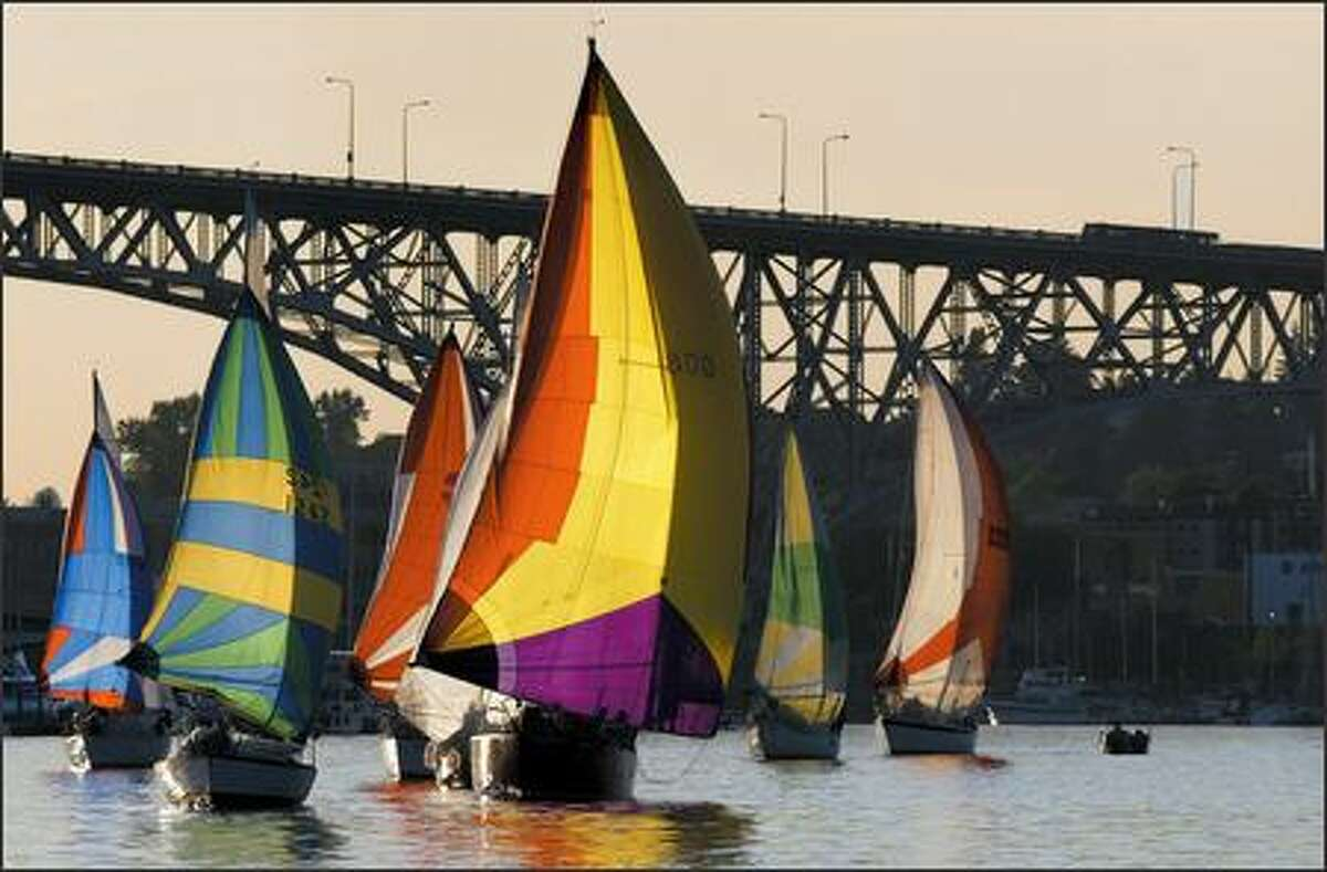 Sailboats use their spinnakers to across Lake Union in Seattle during Duck Dodge on May 22.