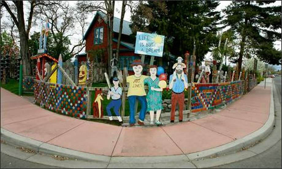 Dick and Jane's Spot in Ellensburg is the home of artists Richard C. Elliott and Jane Orleman, who have decorated their home on Pearl Street with their own work as well as work from more than 40artists. Photo: Gilbert W. Arias, Seattle Post-Intelligencer / Seattle Post-Intelligencer