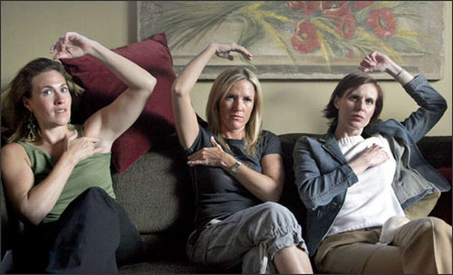 Kerry Rupp, left, Kara Tyler and Christine Gallagher follow along as a facilitator with the non-profit education program Check Your Boobies shows the women how to check their breasts for signs of cancer. Photo: Meryl Schenker, Seattle Post-Intelligencer / Seattle Post-Intelligencer