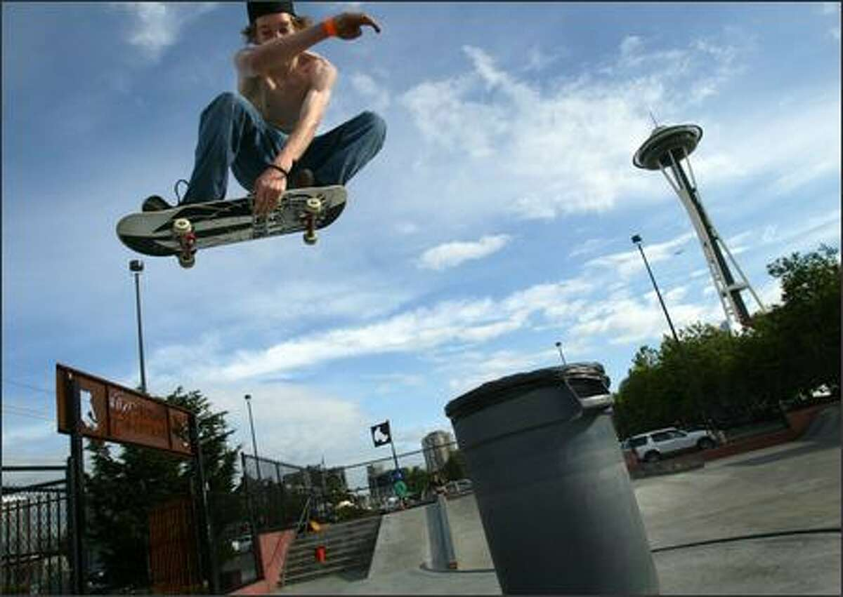 Jason Singler, 17, flies over a trash can Tuesday at the Seattle Center's skate park. The park is scheduled to be torn down, leaving the city with only one for skateboarders. A task force preparing a master plan on where to put new parks for the sport has asked for public opinion on the locations.