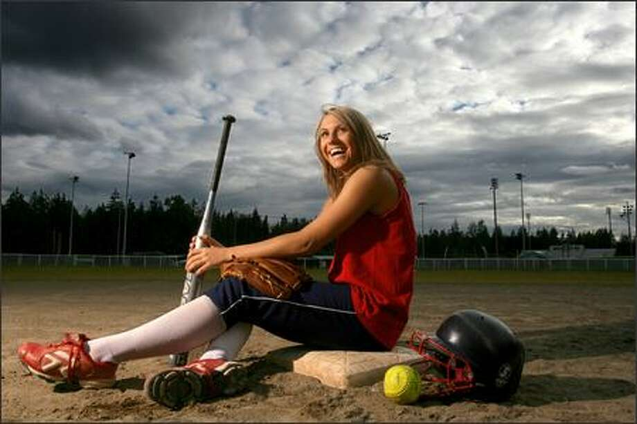 Kimi Pohlman, a junior at Bear Creek School and a four-sport athlete, stars for the Washington Ladyhawks Gold fastpitch team.  Bear Creek doesn't have a fastpitch team. Photo: Scott Eklund, Seattle Post-Intelligencer / Seattle Post-Intelligencer