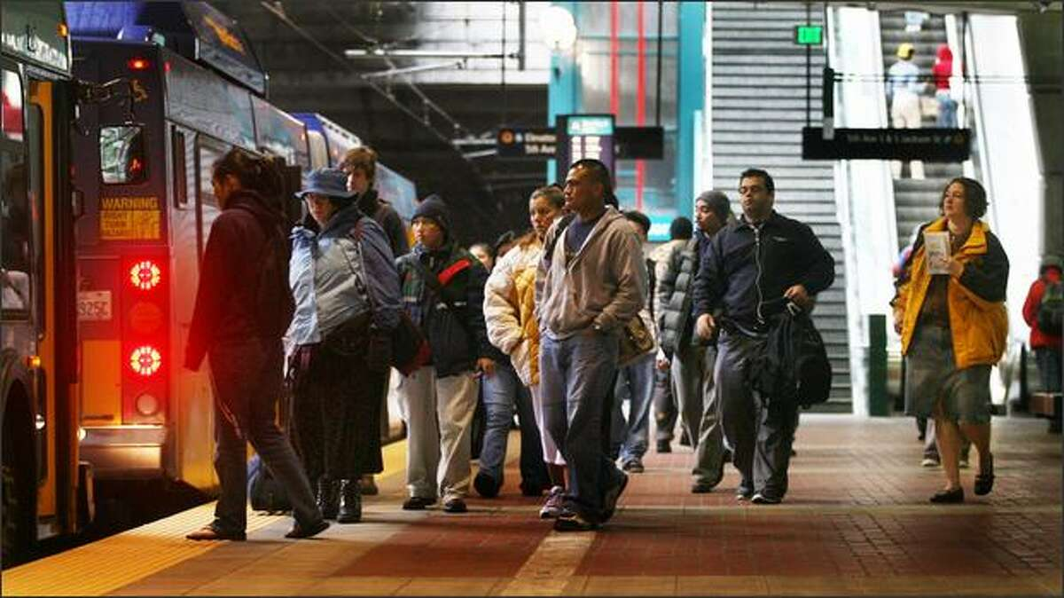Riders wait to board a Metro bus at the International District platform in the bus tunnel. With crowding a concern at peak hours, Metro announced Friday it is adding 22 new buses to ease the situation.