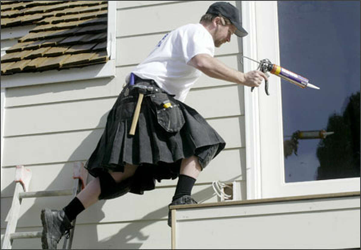 There's little in Lee Bryant's outfit to impede his stretch as he helps to remodel a home in the Blue Ridge neighborhood recently. Bryant, president of Halo Builders Group in North Seattle, is a kilt devotee and has been remodeling and building homes in kilts for more than a year, regardless of weather.