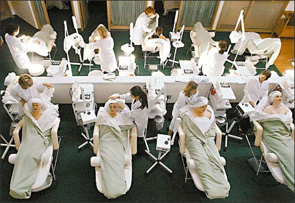 Student estheticians at the Euro Institute practice their skills on fellow students. Though it is at the higher end of training centers, Euro Institute customers still pay a fraction of what they would at a professional salon. Compared with other schools, the ambience is decidely less institutional and more salonlike.