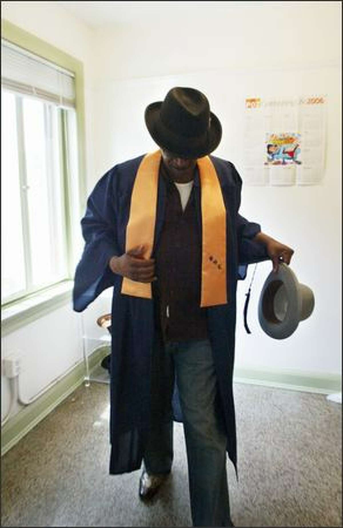 """""""I'm just a major poster child for change,"""" says Alfred White as he dons his both his graduation gown and a deceased friend's hats, which he wears in memory of the friend who died of a drug overdose. White was a pimp, drug dealer and all-around hustler. A brush with death ended all that and put him on the road to recovery."""