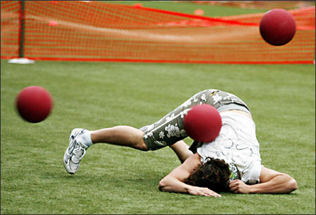 UW student Evan Newton is nailed during a dodgeball tournament at Seahawks Stadium.