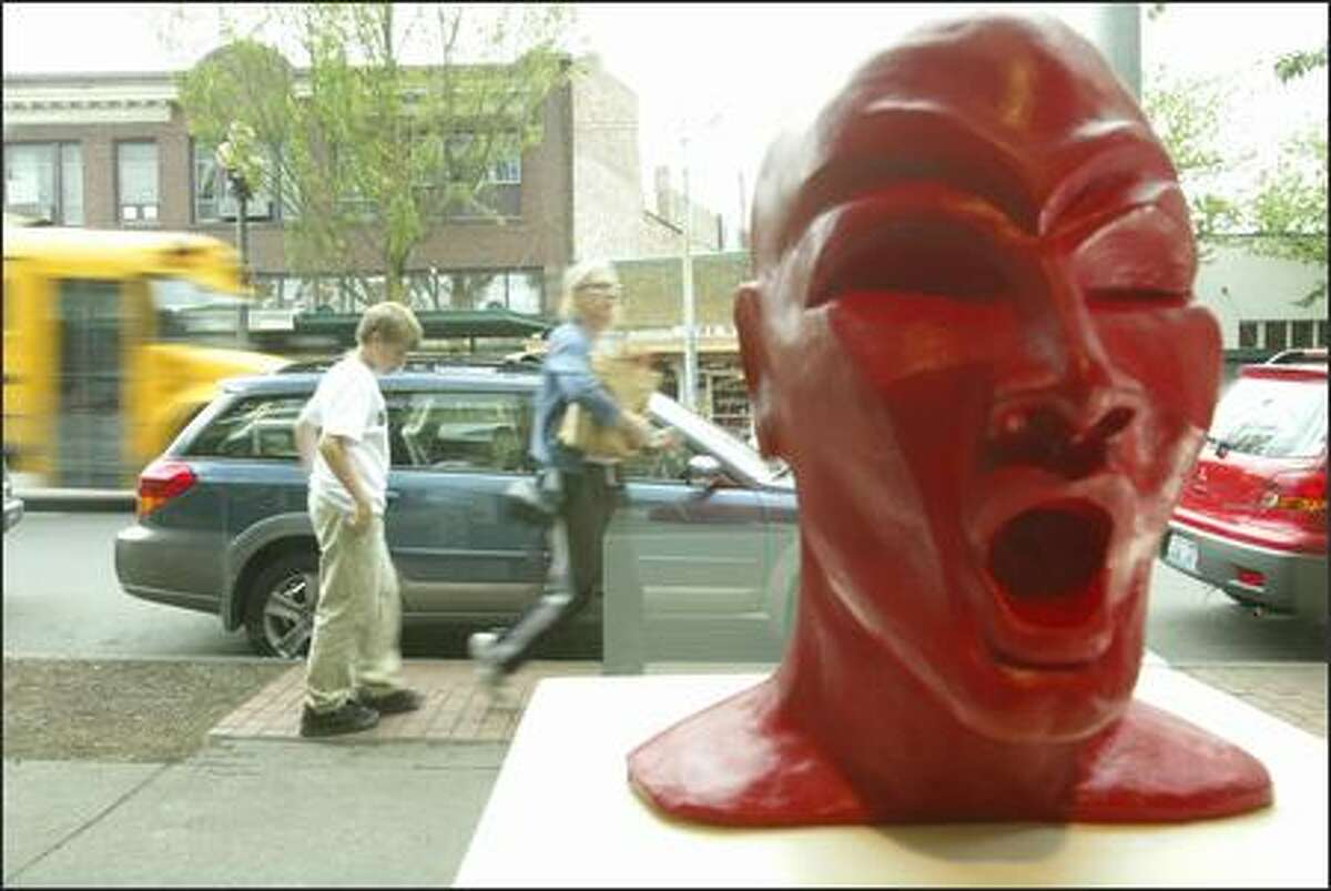 """""""Hot Head,"""" a clay sculpture by Lezlie Jane of Seattle, is seen at the Columbia City Gallery. Columbia City is an example of how dramatically private investment and market forces can transform an area."""