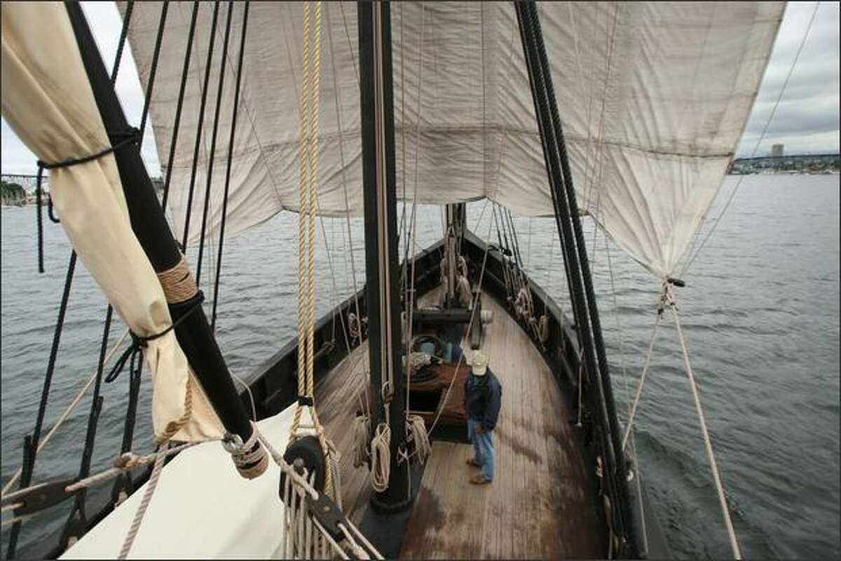 Captain Kyle Friauf stands on deck of La Nina, a hand-built replica of Columbus' ship, under sail on Lake Union. Built in 1992 to honor the 500th year anniversary of Columbus' voyage, it appeared in the film