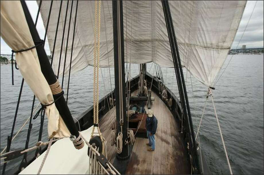 "Captain Kyle Friauf stands on deck of La Nina, a hand-built replica of Columbus' ship, under sail on Lake Union. Built in 1992 to honor the 500th year anniversary of Columbus' voyage, it appeared in the film ""1492"" and has been touring the world ever since. Photo: Mike Kane, Seattle Post-Intelligencer / Seattle Post-Intelligencer"