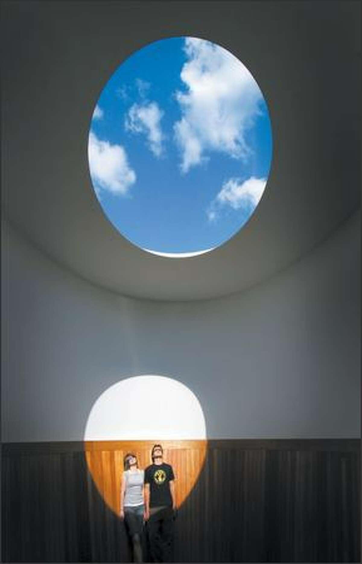 4:48 p.m. -- Molly Theobald and Jeremiah Schiffman of Seattle enjoy some intense solstice sun rays while viewing artist James Turrell's skyspace