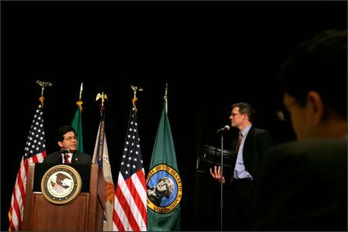 U.S. Attorney General Alberto Gonzales answers questions from John Drescher, executive director of TechNet Northwest, during an appearance at the Westin Hotel in Seattle.