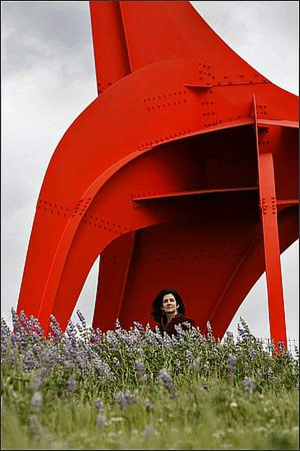 Children's author Blue Balliett shown in front of the Calder sculpture at the SAM Olympic Sculpture Park in Seattle. (Seattle Post-Intelligencer/Mike Urban)