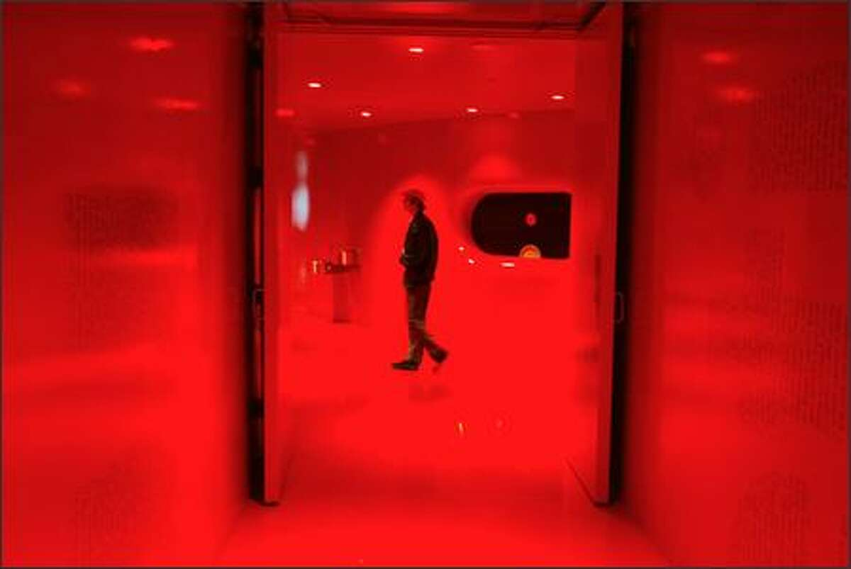 A sea of red embraces visitors to the library's fourth floor like a digestive tract.