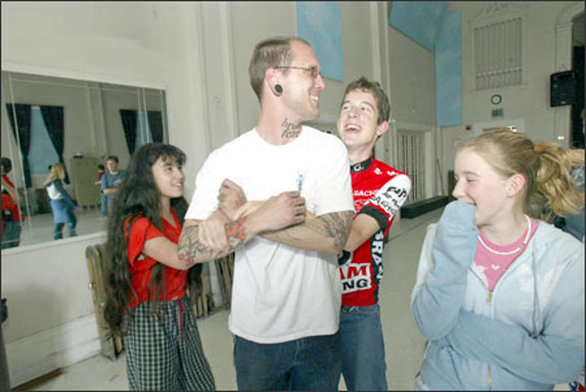 Pupils Rachel Yang, left, Michael Gore and Katie Fellows play with teacher Jeremy Loerch after classes at Billings Middle School in Seattle.