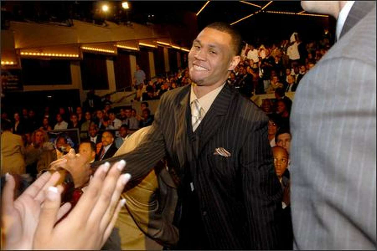 Brandon Roy is congratulated upon being picked sixth overall by Minnesota.