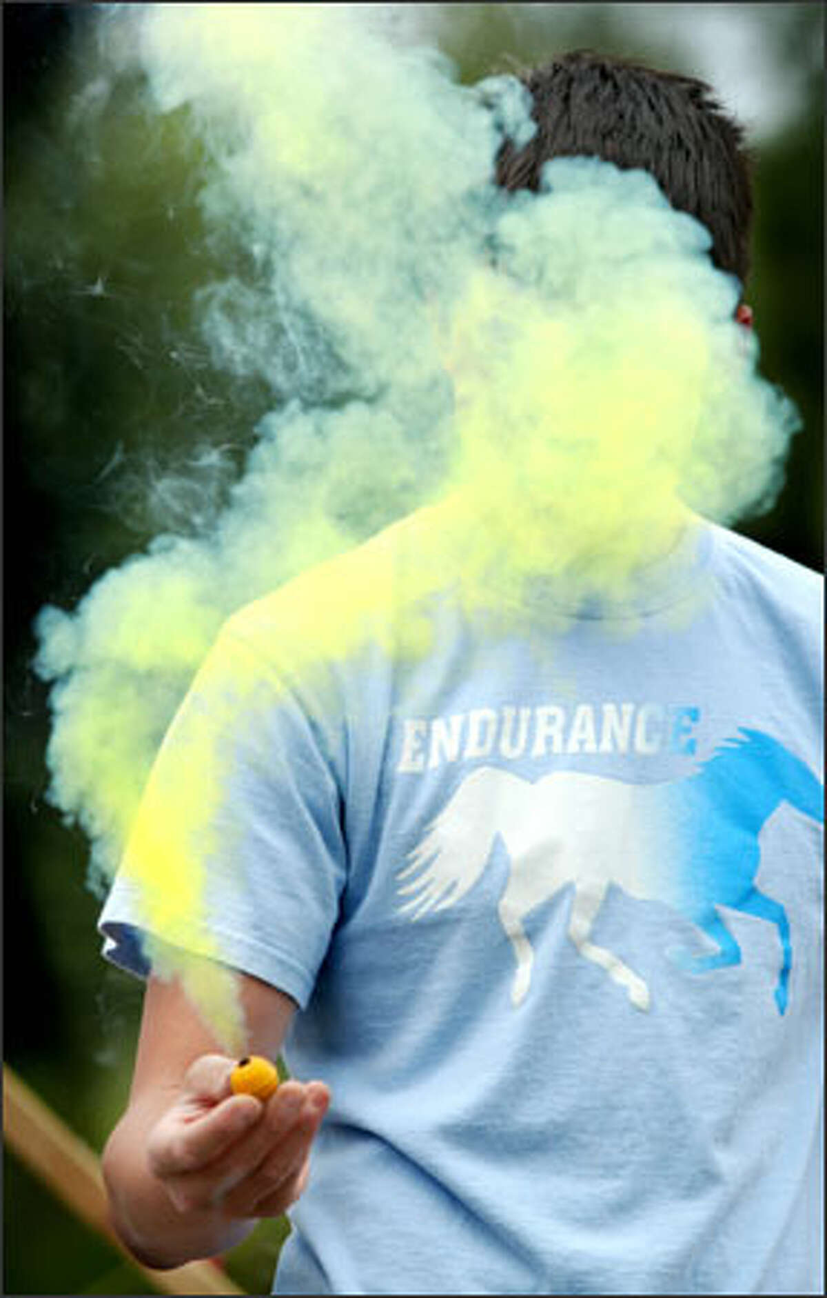 This is no smoke screen: David Montano tests a smoke bomb at Boom City, the Tulalip Tribes' fireworks emporium. Montano and his friends were shopping yesterday for fireworks for the Fourth of July.