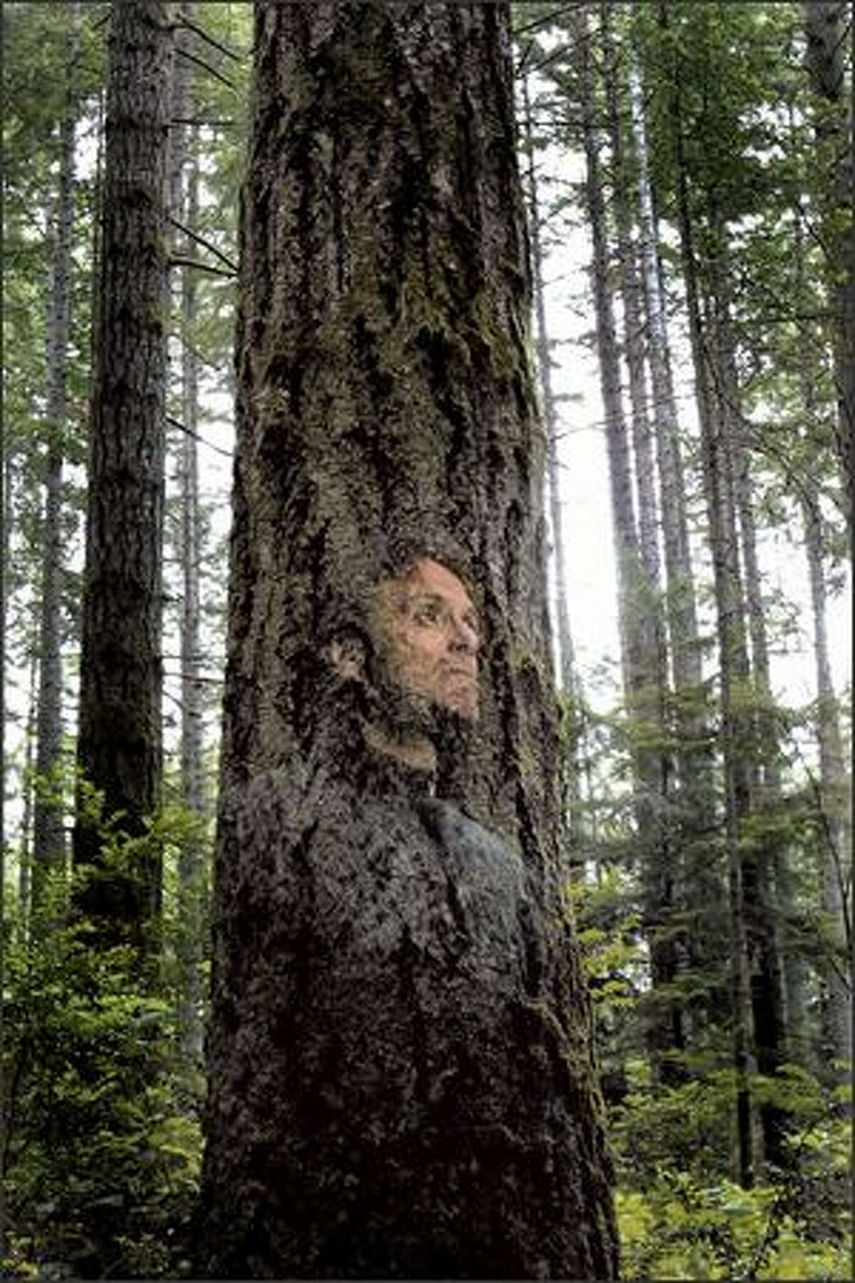 """This """"double exposure"""" of David Guterson was done in a single exposure with a digital camera. He walked out of the frame the moment he saw the flash fire. The flash captured him instantly and the continued time exposure captured the trees."""