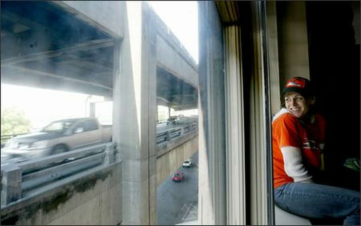 Liz Fairbanks, 31, a longshoreman, looks at the Alaskan Way Viaduct just outside her apartment in the OK Hotel. Tearing down the viaduct would give her a waterfront view.