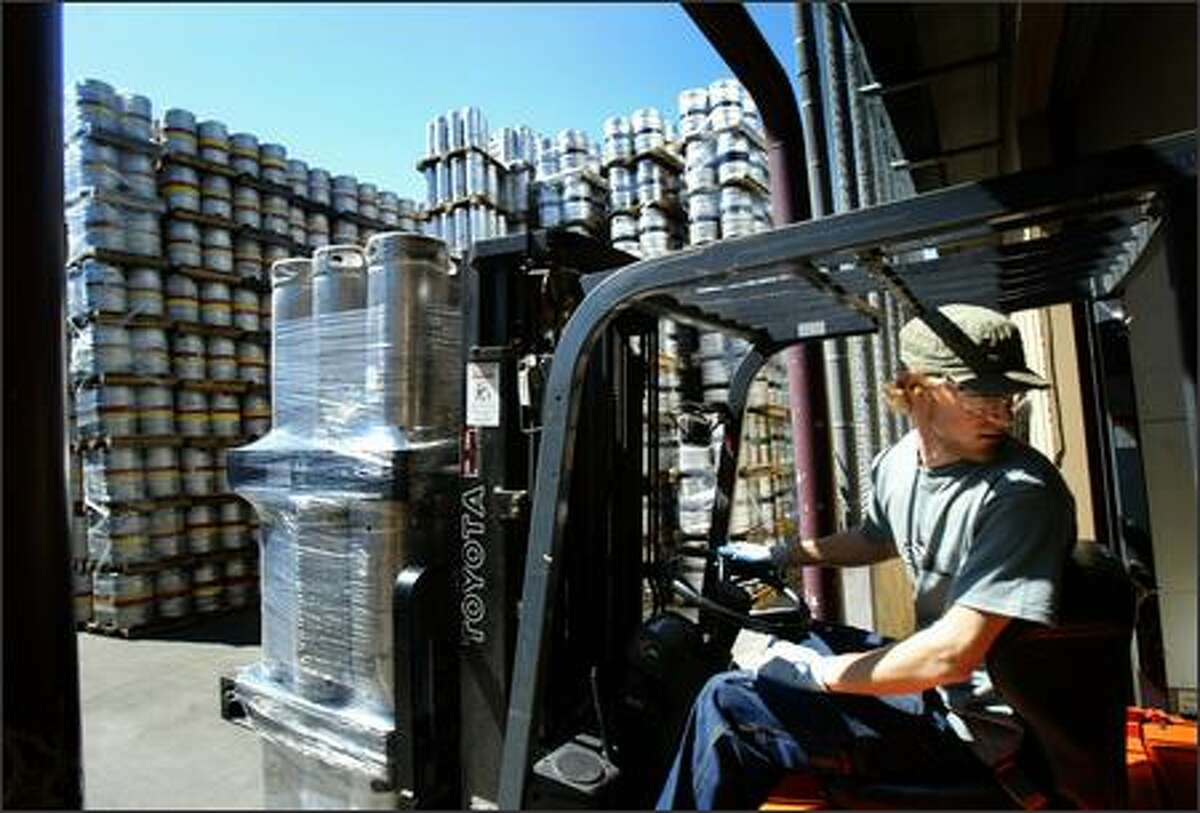Gavin Stankus moves empty beer kegs for filling at Redhook Ale Brewery on Tuesday in Woodinville. There is a nationwide shortage of beer kegs developing as the price of the metal rises, increasing thieves' incentive to steal the kegs and sell them as scrap.
