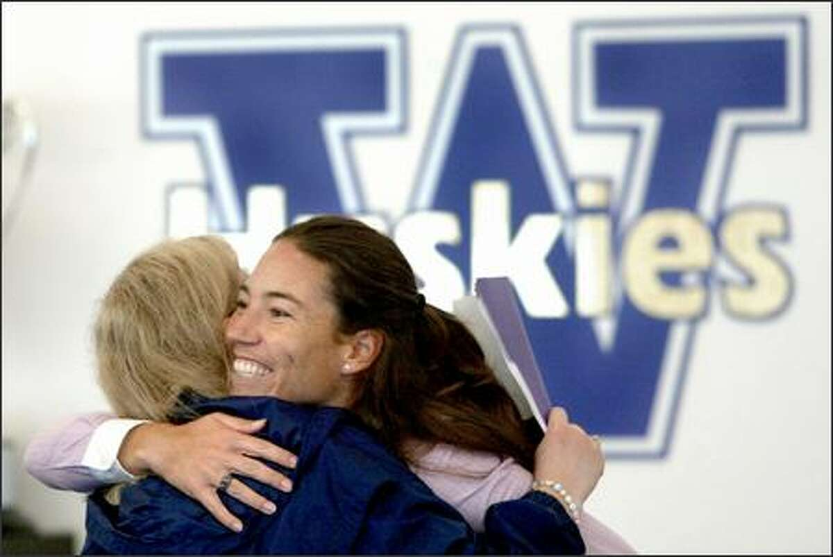 Heather Tarr, right, hugs her former academic advisor, Shona Reid-McLaughlin, prior to Tarr being official announced as the new Washington softball coach.